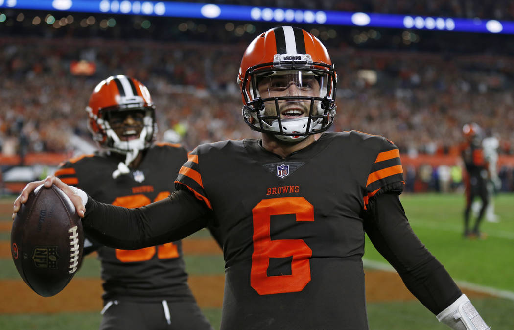 Cleveland Browns quarterback Baker Mayfield celebrates after scoring a 2-point conversion during the second half of an NFL football game against the New York Jets, Thursday, Sept. 20, 2018, in Cle ...