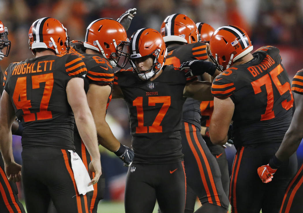 Cleveland Browns kicker Greg Joseph (17) is congratulated by teammates after making a 45-yard field goal during the first half of an NFL football game against the New York Jets, Thursday, Sept. 20 ...