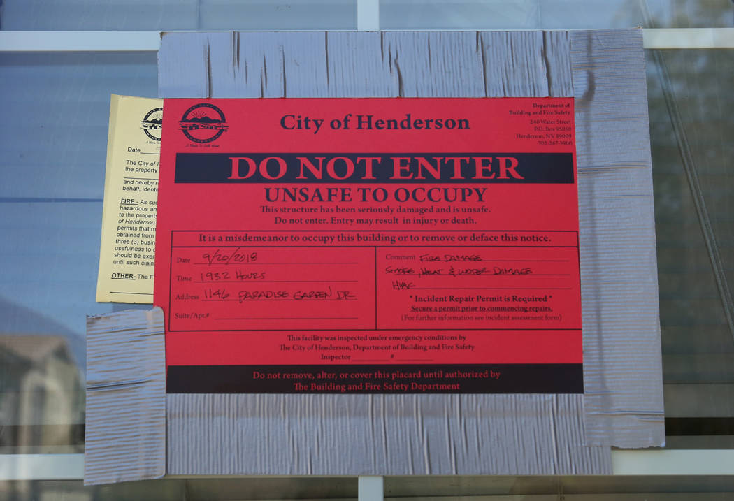 A Do Not Enter notice at a home in the 1100 block of Paradise Garden Drive is posted after police found four people dead inside a burning house after reports of a shooting during a family disturba ...