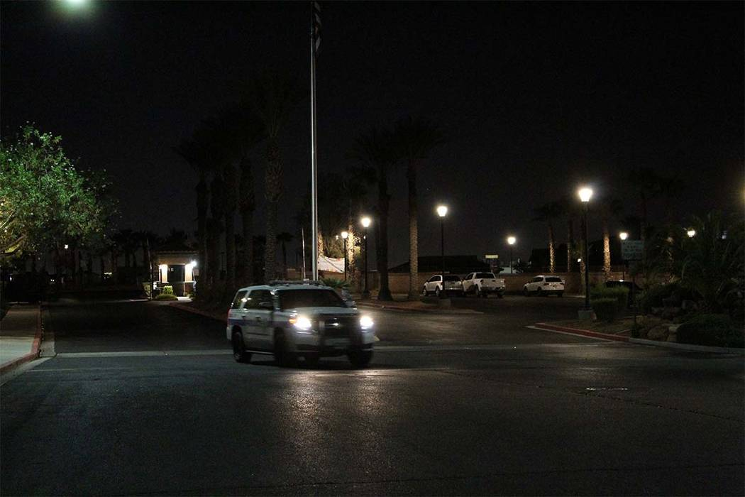 A Henderson police vehicle leaves the gated neighborhood where four people died Thursday night after an apparent murder-suicide. (Max Michor/Las Vegas Review-Journal)