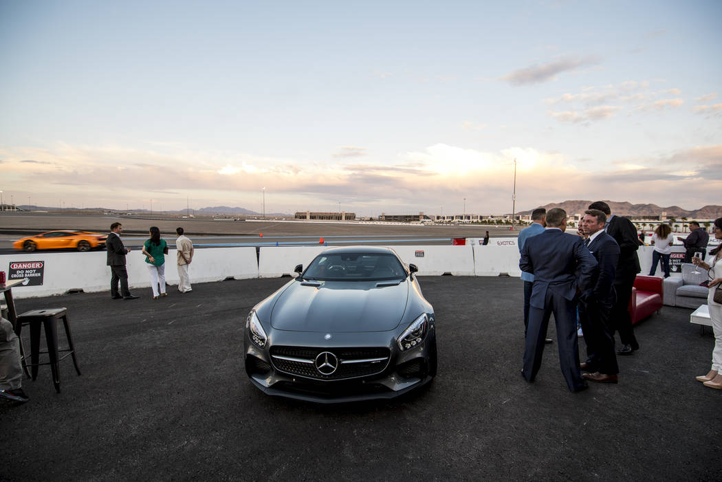 Invited guests tour the new welcome center at Exotics Racing during the grand opening at Las Vegas Motor Speedway in Las Vegas on Thursday, June 4, 2015. (Joshua Dahl/Las Vegas Review-Journal)