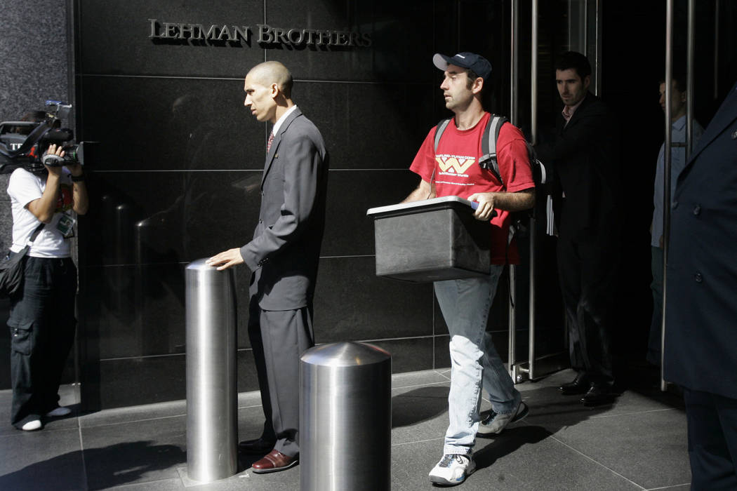 A man leaves the Lehman Brothers headquarters in New York on Sept. 15, 2008, carrying a box. Lehman Brothers, a 158-year-old investment bank choked by the credit crisis and falling real estate val ...