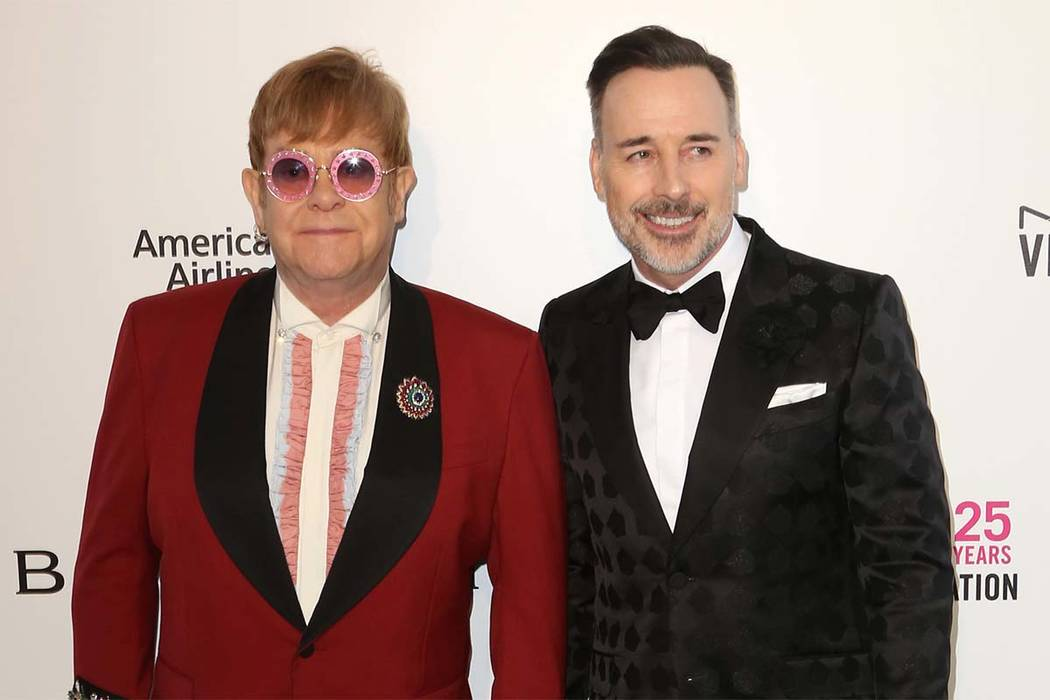 In this Sunday, March 4, 2018 file photo, Elton John, left, and David Furnish arrive at the 2018 Elton John AIDS Foundation Oscar Viewing Party, in West Hollywood, Calif. (Willy Sanjuan/Invisio ...