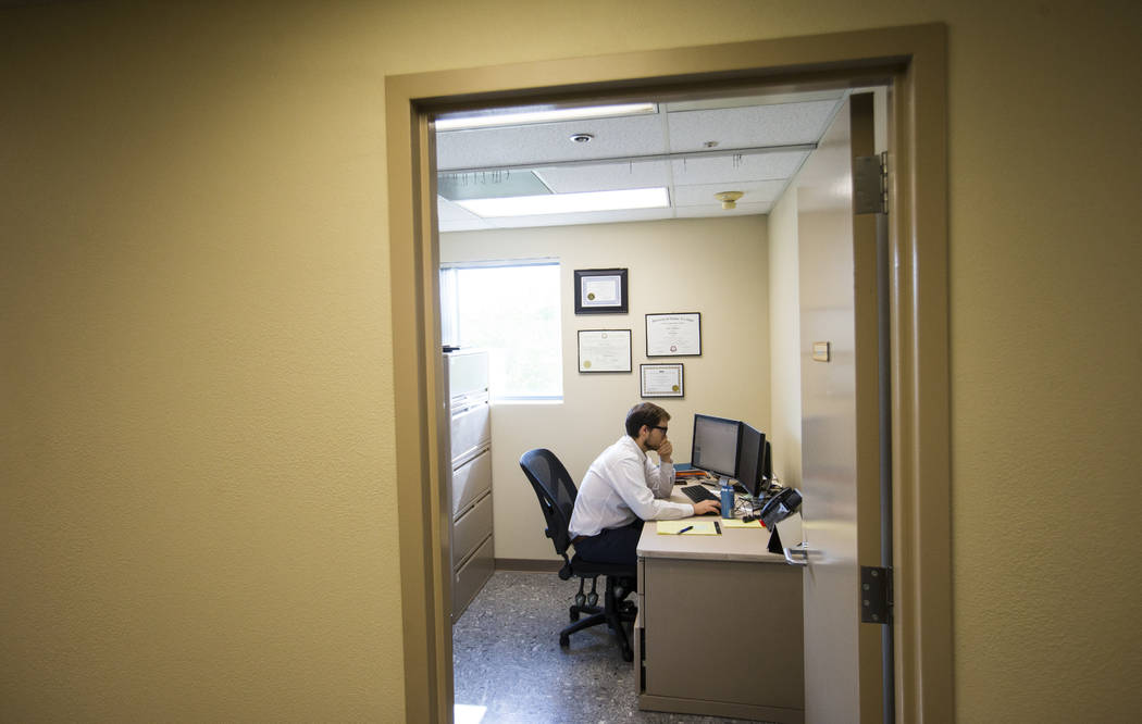 Attorney Tyler Winkler works in his office at the Vegas Strong Resiliency Center in Las Vegas on July 31, 2018. Chase Stevens Las Vegas Review-Journal @csstevensphoto