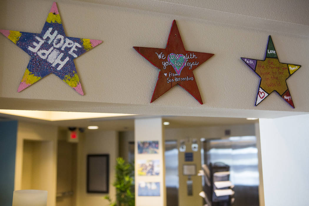 Wooden stars that came from San Bernardino, California, as part of the Stars of Hope on display at the Vegas Strong Resiliency Center in Las Vegas on July 31, 2018. Chase Stevens Las Vegas Review- ...