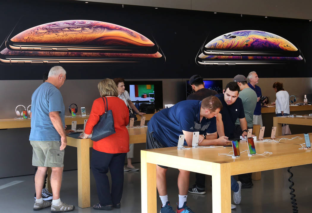 People check out the new iPhone XS and XS Max at an Apple Store in Summerlin on Friday, Sept. 21, 2018. (Bizuayehu Tesfaye/Las Vegas Review-Journal) @bizutesfaye