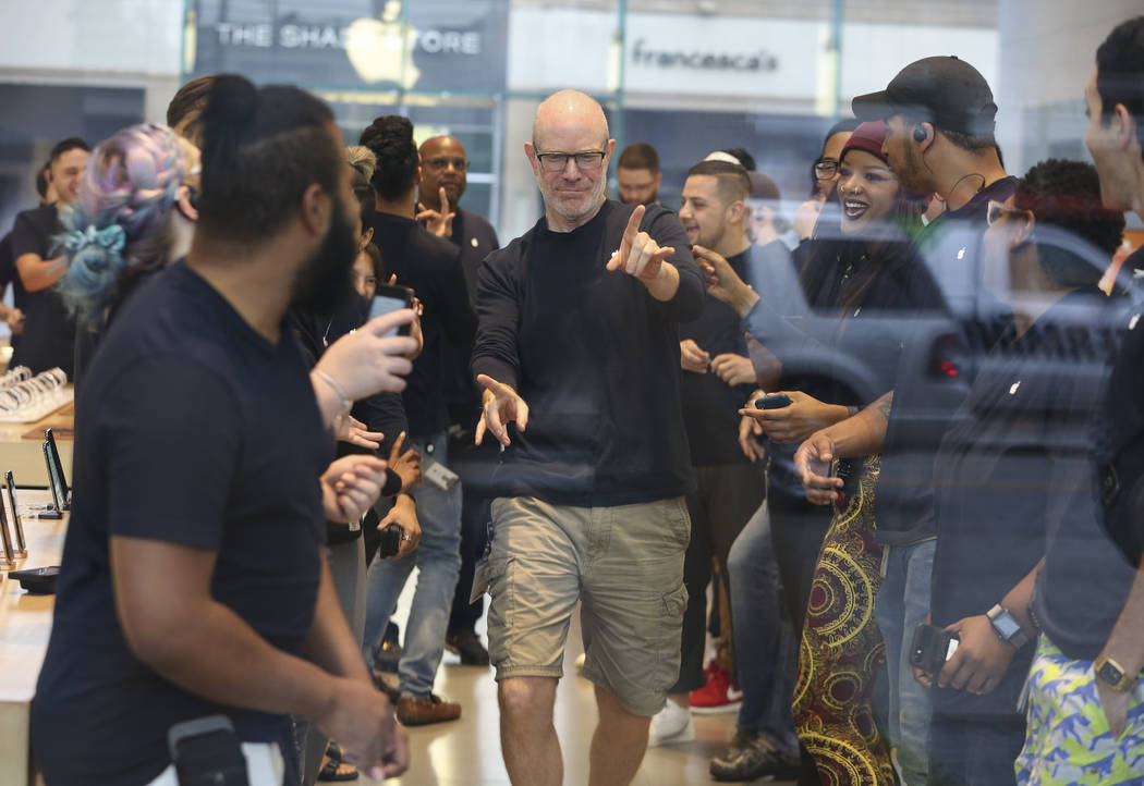 Highland Village Apple store staff rally before open its doors for customers on Friday, Sept. 21, 2018, in Houston. The newly released products included the iPhone XS, iPhone XS Max and the Series ...