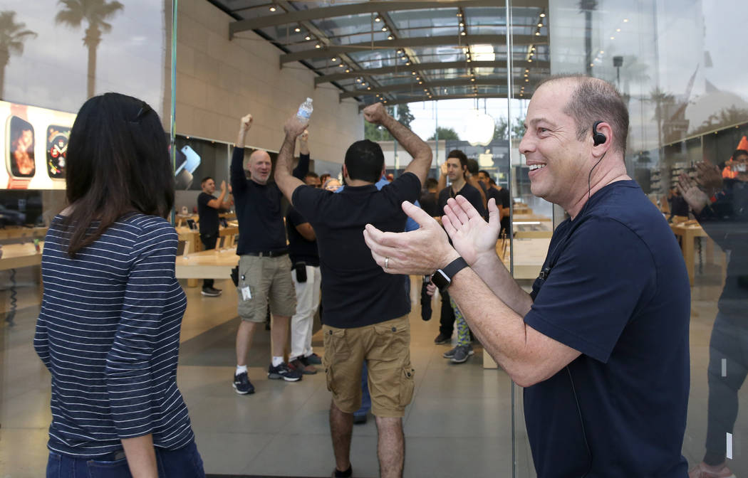 The Highland Village Apple store welcomes early customers to purchase new products on Friday, Sept. 21, 2018, in Houston. The newly released products included the iPhone XS, iPhone XS Max and the ...