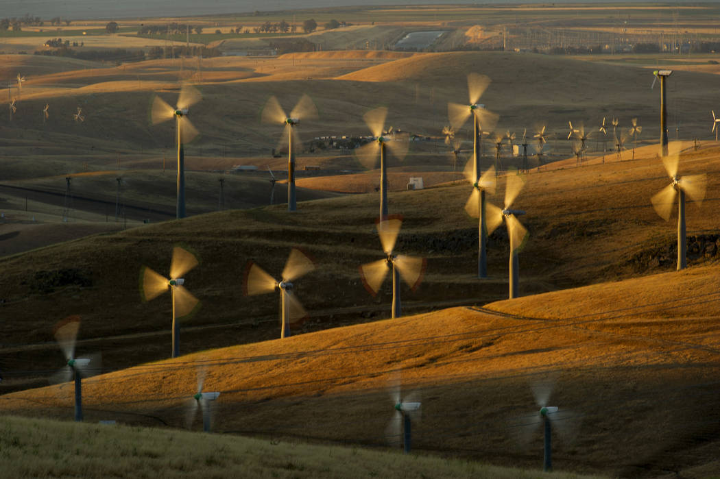 Wind turbines lining the Altamont Pass near Livermore, Calif., generate electricity on May 12, 2013. A California legislative panel is debating a proposal to move up the state's target for using 5 ...