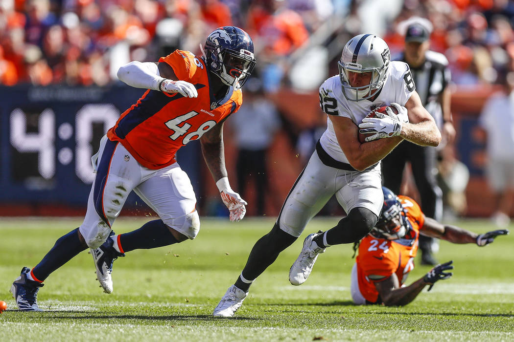Oakland Raiders wide receiver Jordy Nelson (82) runs from Denver Broncos linebacker Shaquil Barrett (48) during the first half of an NFL football game, Sunday, Sept. 16, 2018, in Denver. (AP Photo ...