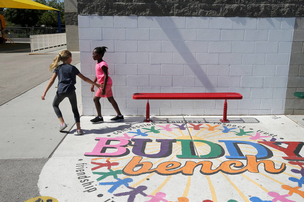 Walter Bracken STEAM Academy third graders Mila Lederer, left, and Chloe Anakwa in front of a space for a mural at the Las Vegas school Tuesday, Sept. 25, 2018. The mural will be filled with a rai ...