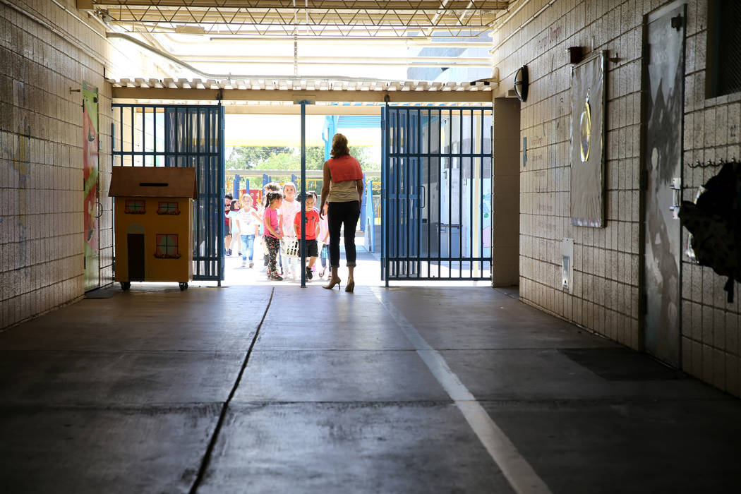 Walter Bracken STEAM Academy students come in from recess at the Las Vegas school Tuesday, Sept. 25, 2018. Students and volunteers will clean and beautify the school during the United Way of South ...