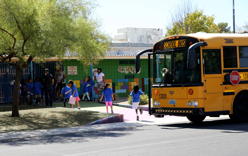 Walter Bracken STEAM Academy students come in from the bus at the Las Vegas school Tuesday, Sept. 25, 2018. Students and volunteers will clean and beautify the school during the United Way of Sout ...