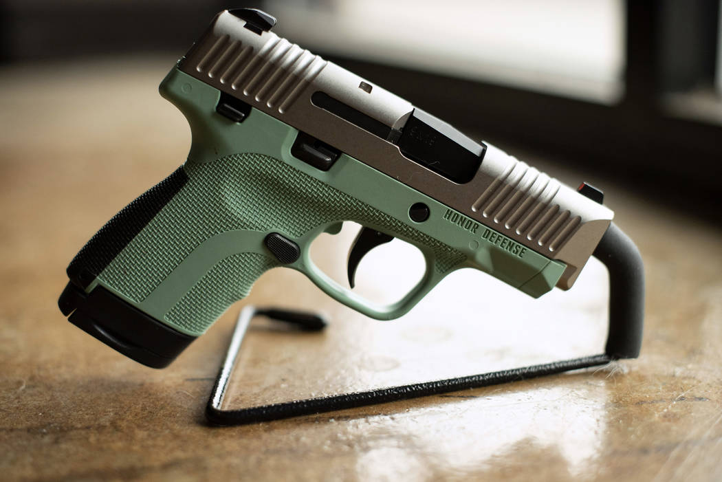 In this April 25, 2018 photo, a .9mm handgun produced by Honor Defense, a gunmaker in Gainesville, Ga., is displayed. In the wake of high-profile mass shootings, corporate America has been taking ...