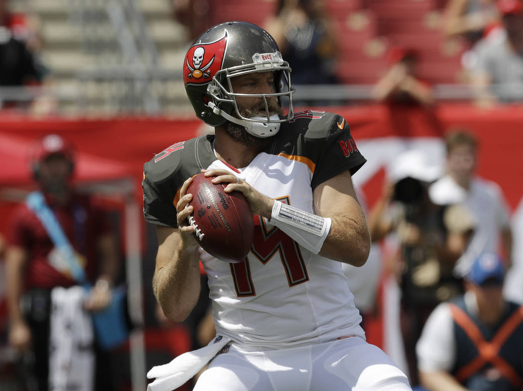 Tampa Bay Buccaneers quarterback Ryan Fitzpatrick (14) looks to pass,during the first half of an NFL football against the Philadelphia Eagles, Sunday, Sept. 16, 2018, in Tampa, Fla. (AP Photo/Chri ...