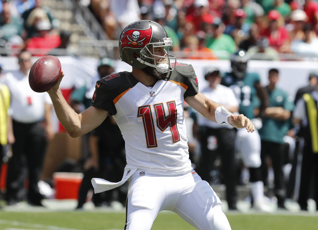 Tampa Bay Buccaneers quarterback Ryan Fitzpatrick (14) looks to pass, during the first half of an NFL football game against the Philadelphia Eagles, Sunday, Sept. 16, 2018, in Tampa, Fla. (AP Phot ...