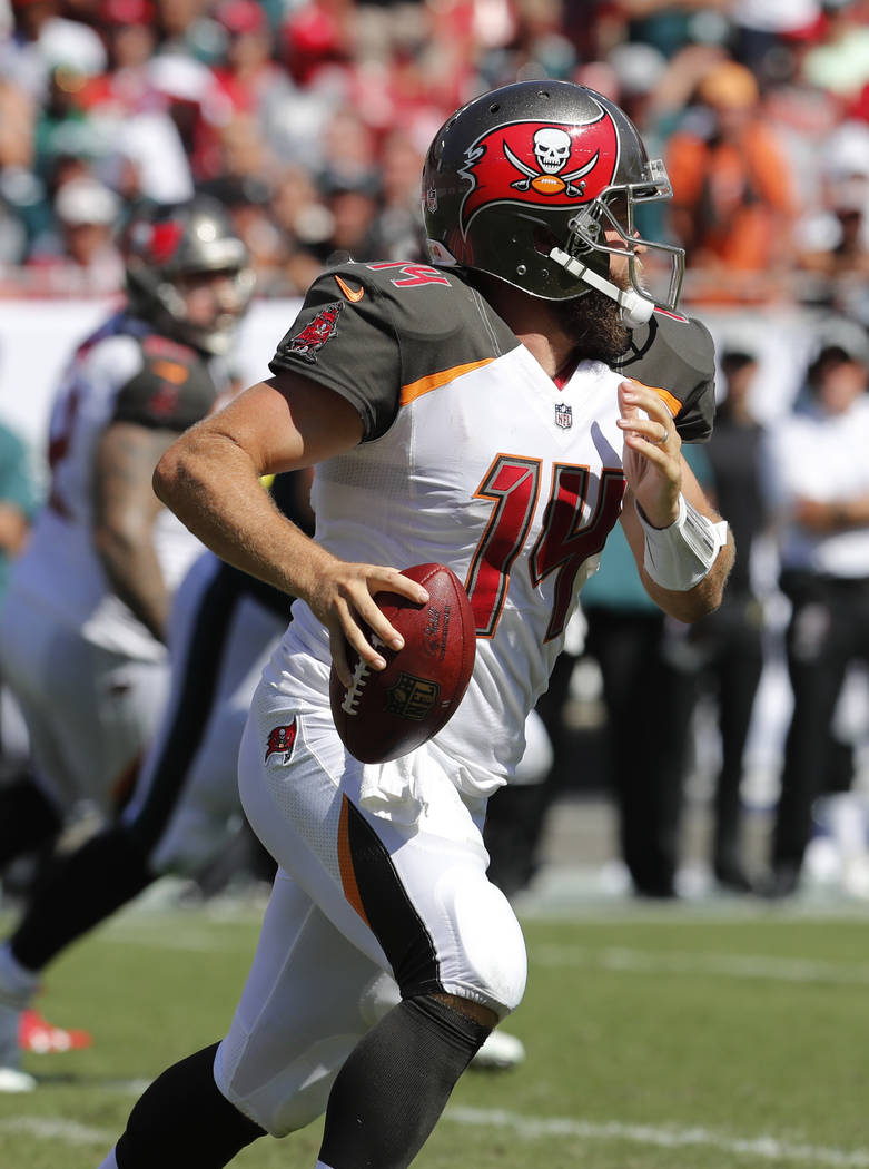 Tampa Bay Buccaneers quarterback Ryan Fitzpatrick (14) looks to pass, during the second half of an NFL football game against the Philadelphia Eagles, Sunday, Sept. 16, 2018, in Tampa, Fla. (AP Pho ...