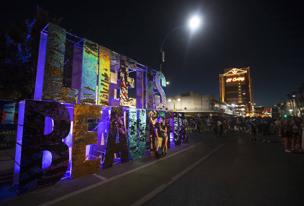 Festival-goers pose at a Life is Beautiful sign on Day 2 of the annual Life is Beautiful festival in downtown Las Vegas on Saturday, Sept. 22, 2018. Richard Brian Las Vegas Review-Journal @vegasph ...