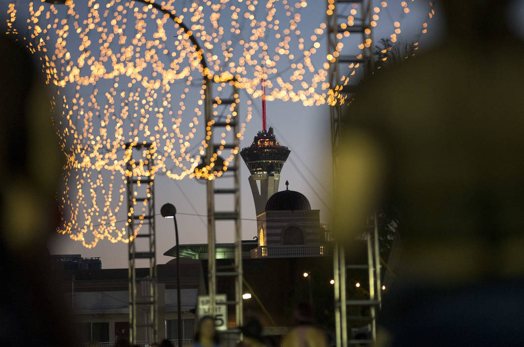 The Stratosphere observation tower is seen from under an illuminated canopy on Day 2 of the annual Life is Beautiful festival in downtown Las Vegas on Saturday, Sept. 22, 2018. Richard Brian Las V ...