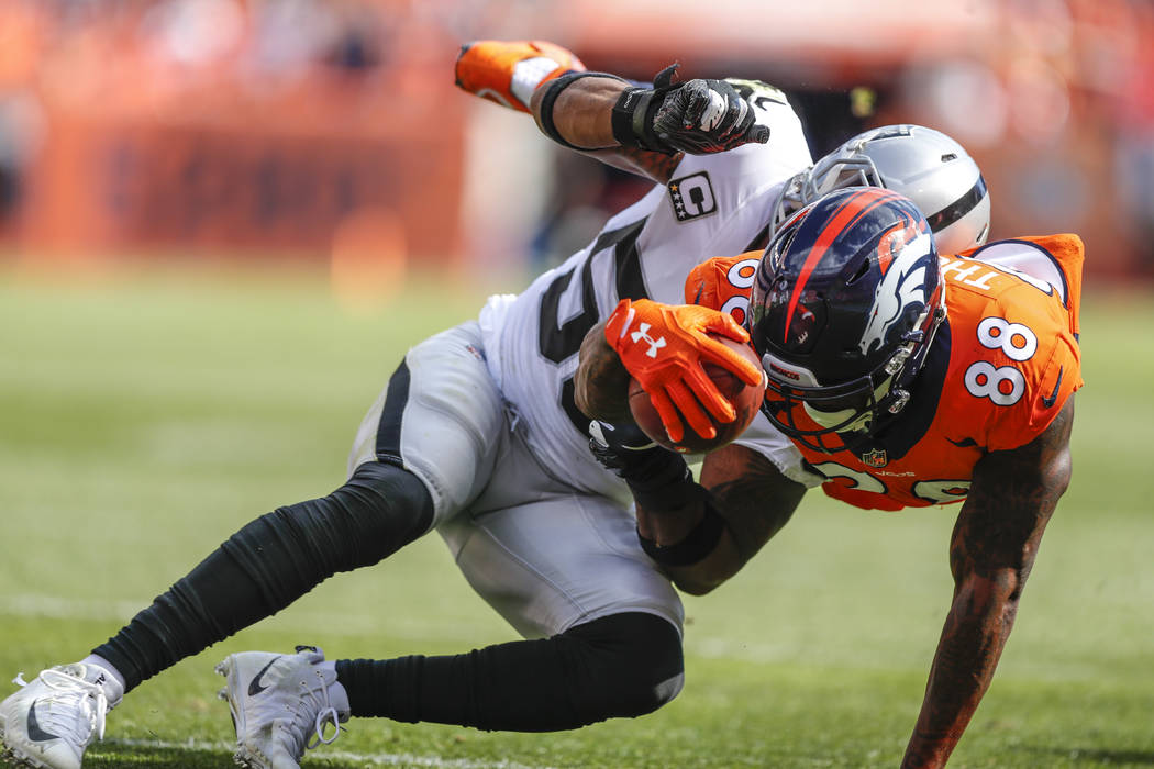 Denver Broncos wide receiver Demaryius Thomas (88) is hit by Oakland Raiders linebacker Derrick Johnson (56) during the second half of an NFL football game, Sunday, Sept. 16, 2018, in Denver. (AP ...