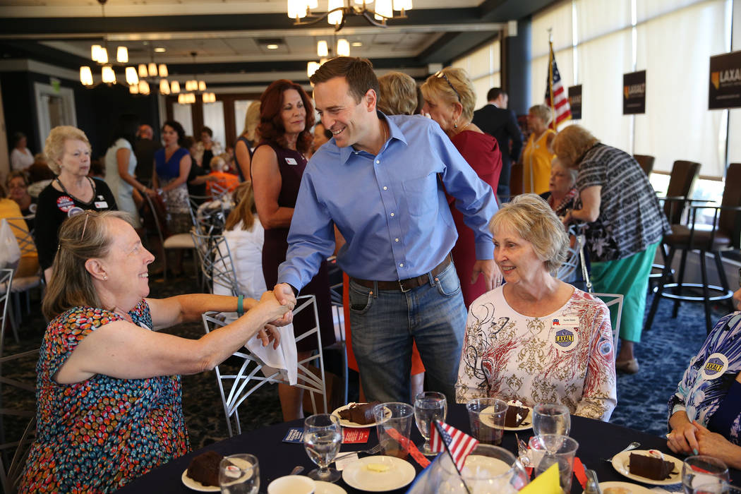 Republican candidate for governor Adam Laxalt, center, meets attendee Kitty Clark, left, during the Southern Hills Republican Women's Club luncheon at Buckman's Grille in Henderson, Tuesday, Aug. ...