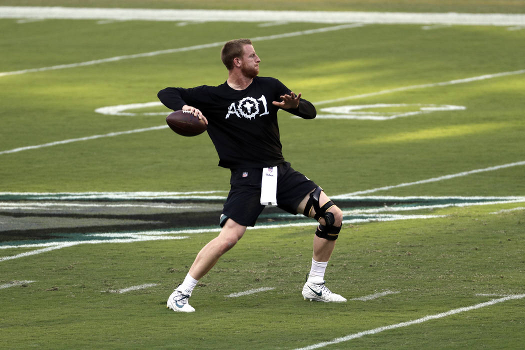 Philadelphia Eagles' Carson Wentz warms up before an NFL football game against the Atlanta Falcons, Thursday, Sept. 6, 2018, in Philadelphia. (AP Photo/Michael Perez)