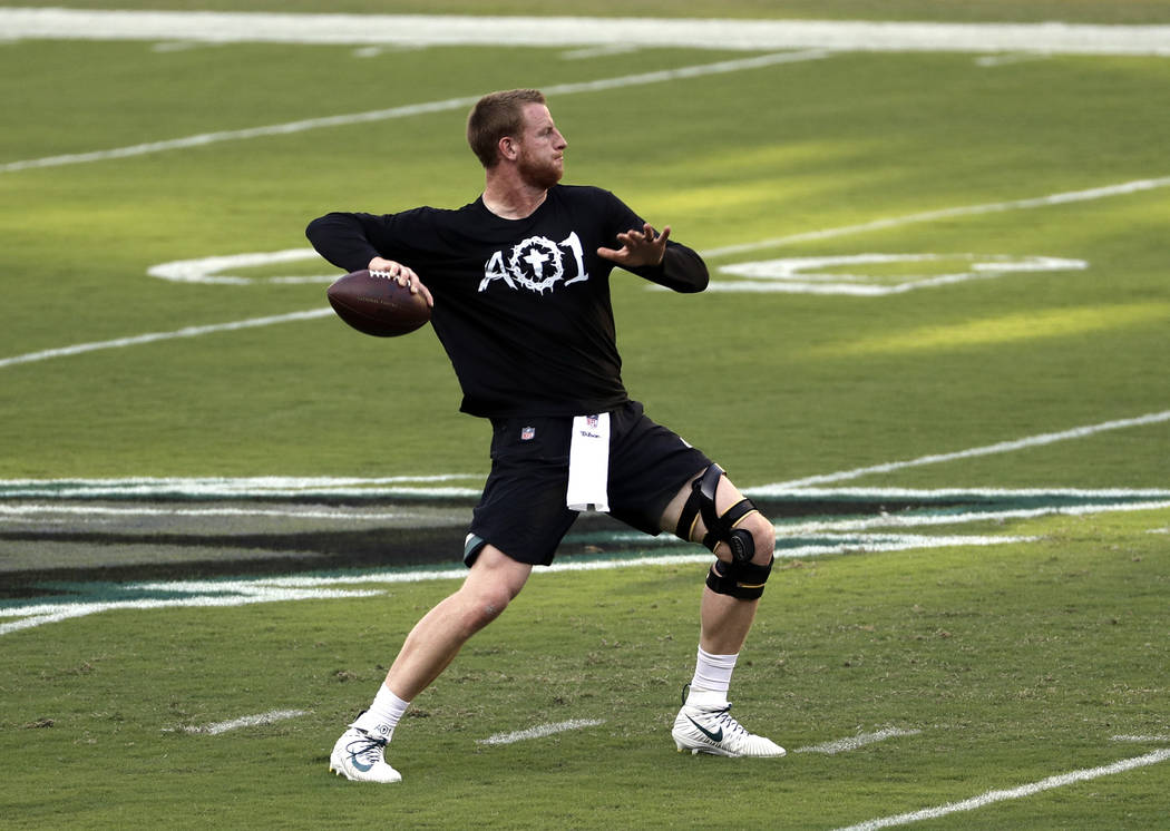FILE - In this Sept. 6, 2018, file photo, Philadelphia Eagles quarterback Carson Wentz throws a pass before the team's NFL football game against the Atlanta Falcons in Philadelphia. Wentz will be ...