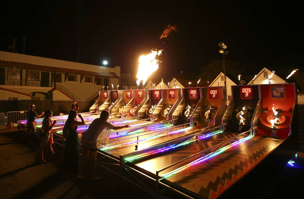 Attendees play flaming skeeball during the first day of the annual Life is Beautiful festival in downtown Las Vegas on Friday, Sept. 21, 2018. Chase Stevens Las Vegas Review-Journal @csstevensphoto