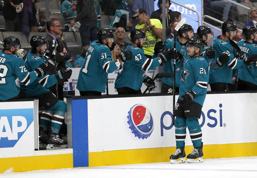 San Jose Sharks right wing Timo Meier (28) is congratulated by teammates after scoring a goal against the Vegas Golden Knights during the first period of a preseason NHL hockey game in San Jose, C ...