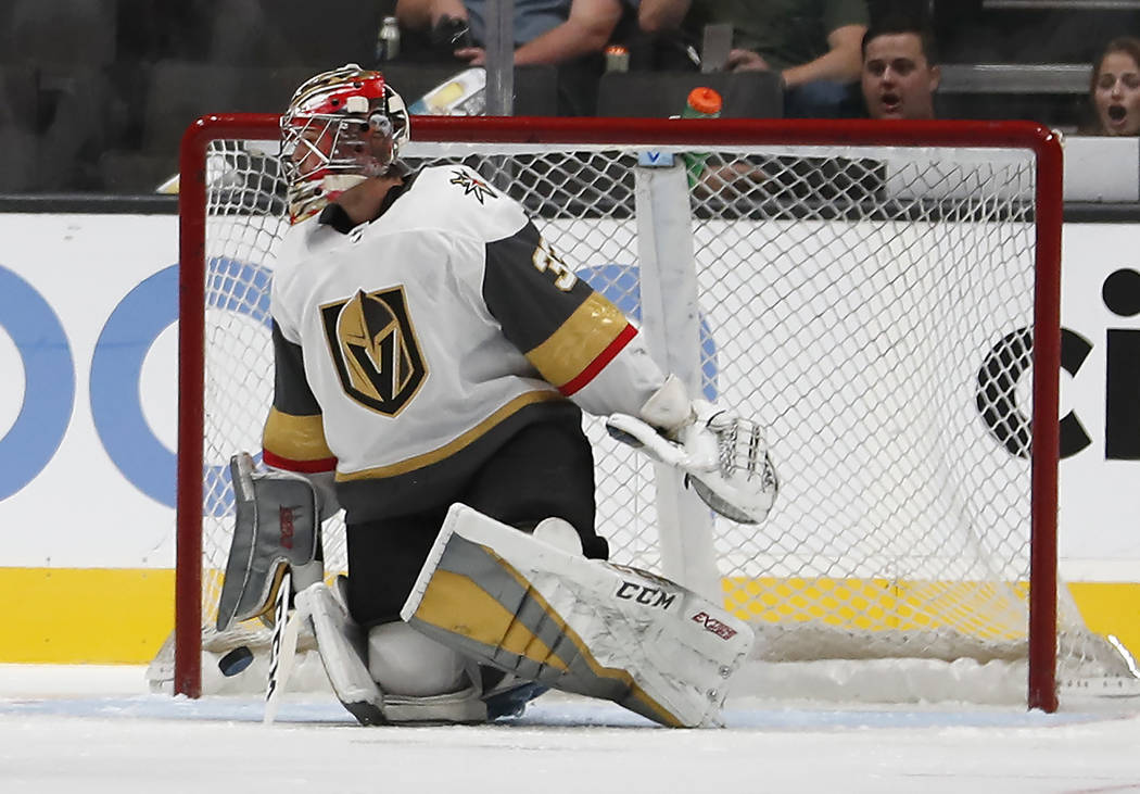 Vegas Golden Knights goaltender Maxime Lagace (33) looks back at the puck after allowing a goal to San Jose Sharks defenseman Brent Burns during the first period of a preseason NHL hockey game in ...