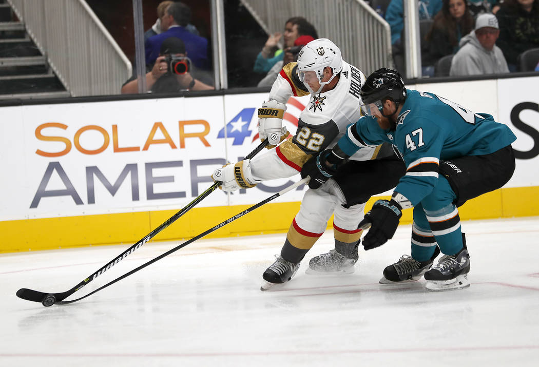 Vegas Golden Knights defenseman Nick Holden (22) competes for the puck against San Jose Sharks defenseman Joakim Ryan (47) during the first period of a preseason NHL hockey game in San Jose, Calif ...