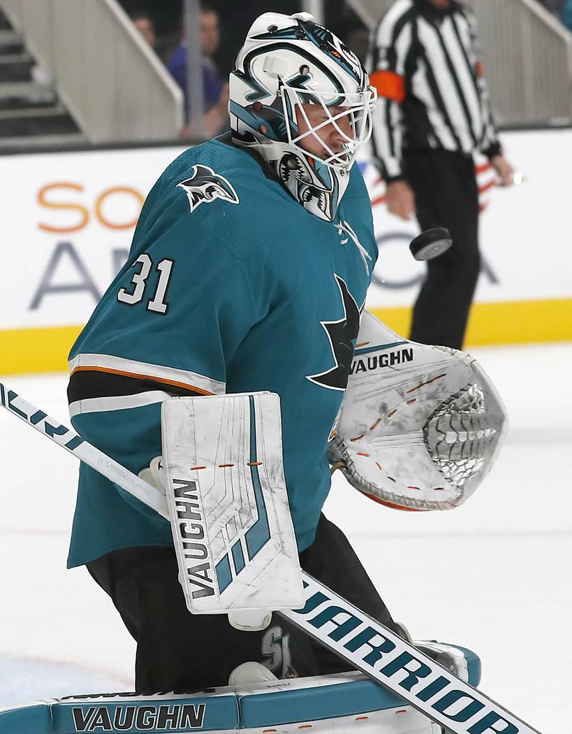 San Jose Sharks goaltender Martin Jones blocks a shot by Vegas Golden Knights center Paul Stastny during the first period of a preseason NHL hockey game in San Jose, Calif., Saturday, Sept. 22, 20 ...
