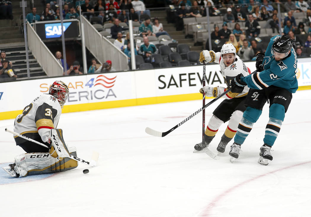 Vegas Golden Knights goaltender Maxime Lagace, left, blocks a shot by San Jose Sharks right wing Barclay Goodrow (23) during the second period of a preseason NHL hockey game in San Jose, Calif., S ...