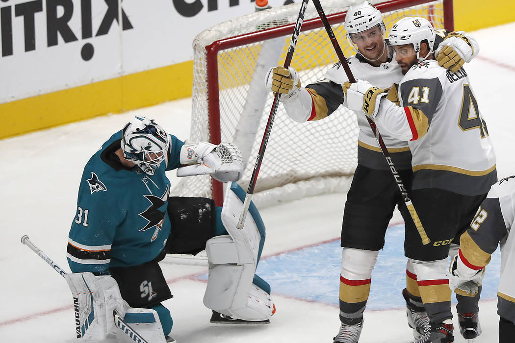 Vegas Golden Knights left wing Pierre-Edouard Bellemare (41) celebrates with Ryan Carpenter (40) after scoring a goal past San Jose Sharks goaltender Martin Jones (31) during the third period of a ...