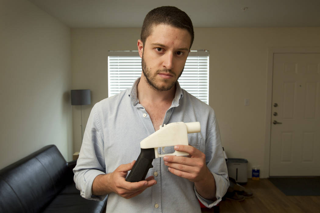 Cody Wilson, the founder of Defense Distributed, shows a plastic handgun made on a 3D-printer at his home in Austin, Texas, May 10, 2013. Police allege in an affidavit filed Wednesday, Sept. 19, ...
