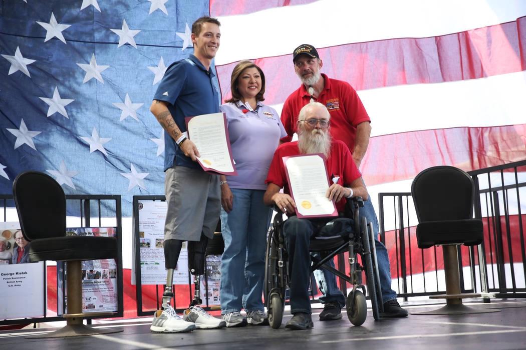 U.S. Army Sgt. Adam Poppenhouse, clockwise from left, Henderson Councilwoman Gerri Schroder, Rick Hillis, founder of One Hero at a Time, and Army veteran Daniel Holman, are photographed during an ...