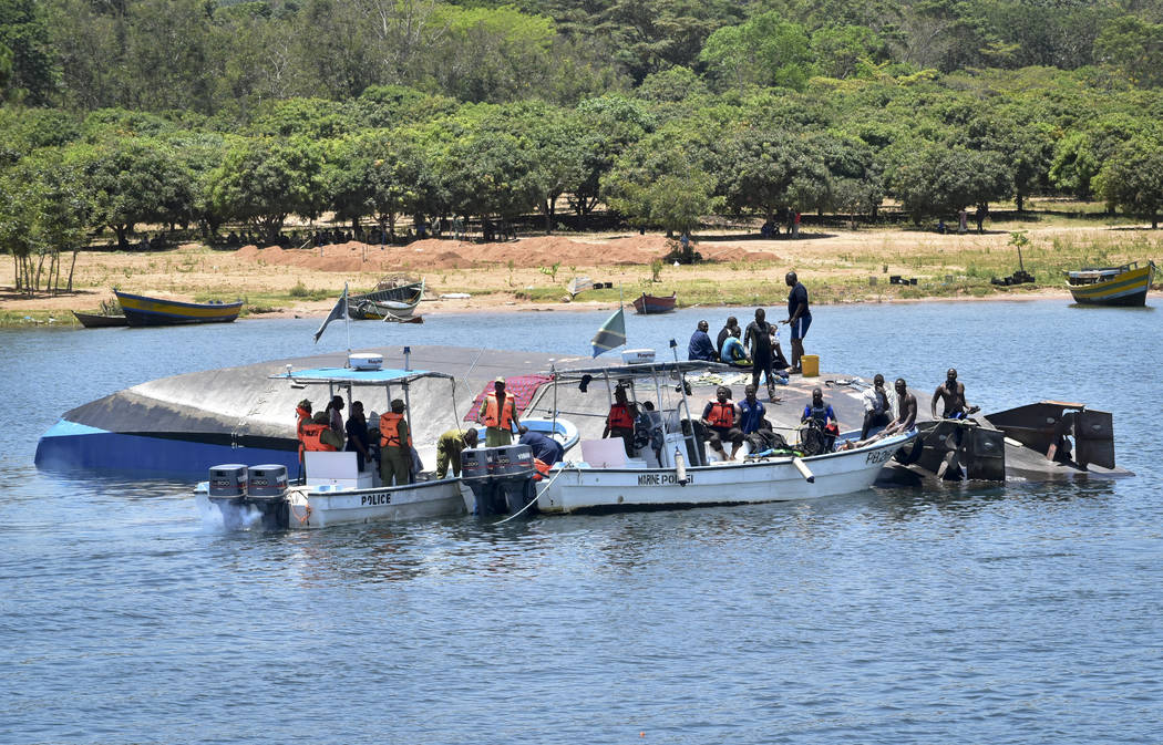 Rescue divers work alongside the capsized MV Nyerere passenger ferry on Ukara Island, Tanzania Saturday, Sept. 22, 2018. The death toll soared past 200 on Saturday while officials said a survivor ...