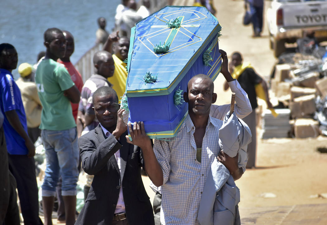 Men carry a coffin for one of the victims of the MV Nyerere passenger ferry on Ukara Island, Tanzania Saturday, Sept. 22, 2018. The death toll soared past 200 on Saturday while officials said a su ...