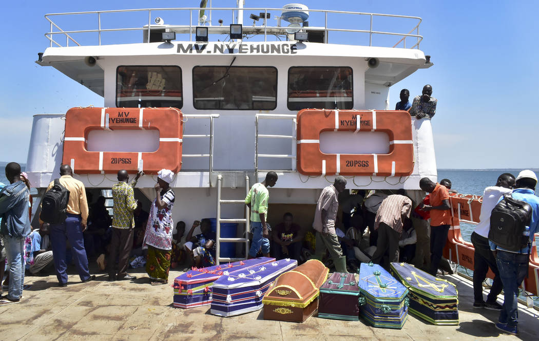 Coffins for the victims of the MV Nyerere passenger ferry are transported by another ferry to Ukara Island, Tanzania Saturday, Sept. 22, 2018. The death toll soared past 200 on Saturday while offi ...