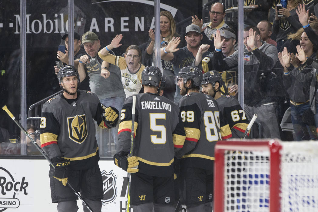 Golden Knights left wing Max Pacioretty (67) celebrates with teammates Brayden McNabb (3), Deryk Engelland (5) and Alex Tuch (89) after Pacioretty scored a second period goal during Vegas' NHL pre ...