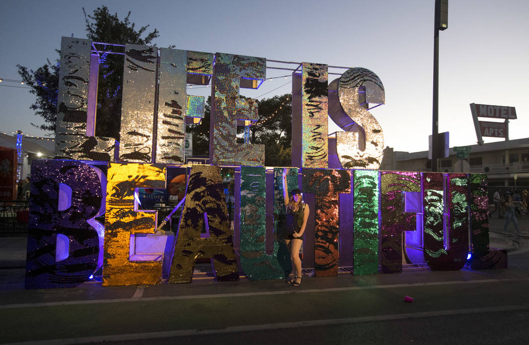 A festival-goer poses at a Life is Beautiful sign on day two of the annual Life is Beautiful festival in downtown Las Vegas on Saturday, Sept. 22, 2018. Richard Brian Las Vegas Review-Journal @veg ...