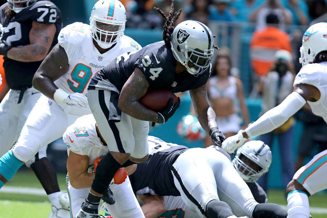 Oakland Raiders running back Marshawn Lynch (24) tries to break the tackle from Miami Dolphins linebacker Kiko Alonso (47) during the first half of their NFL game in Miami Gardens, Fla., Sunday, S ...