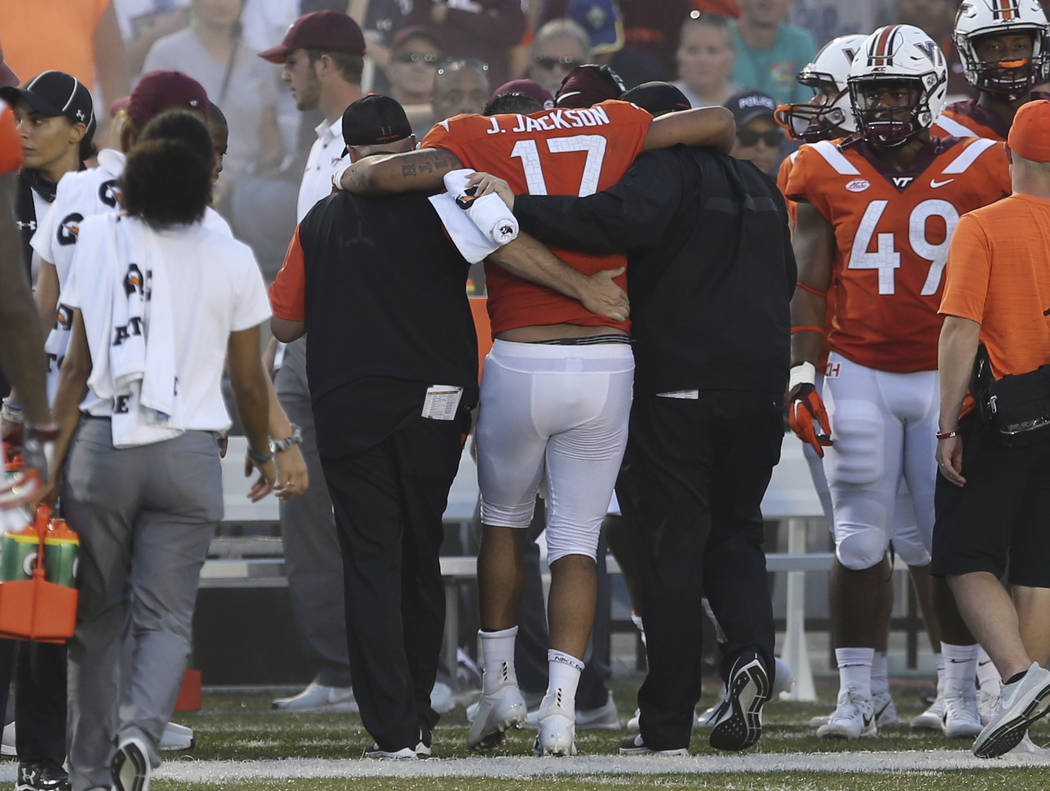 Virginia Tech quarterback Josh Jackson is helped off the field during the second half of an NCAA college football game against Old Dominion, Saturday, Sept. 22, 2018, in Norfolk, Va. Old Dominion ...