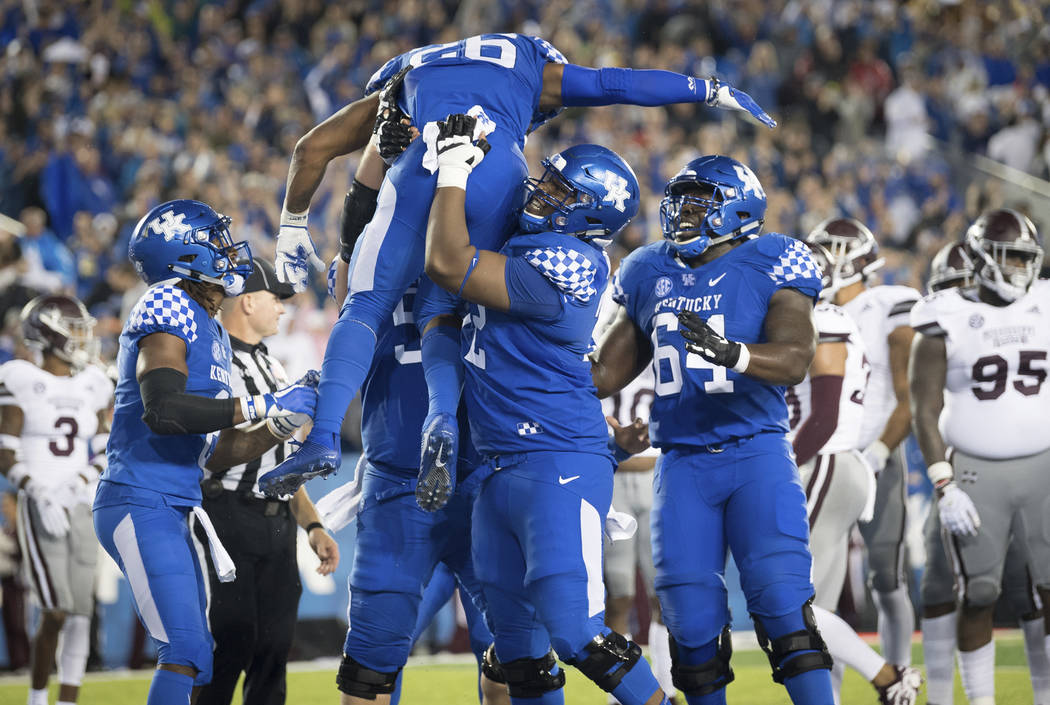 Kentucky running back Benny Snell Jr. (26) is hoisted in celebration following his touchdown during the first half of an NCAA college football game against Mississippi State in Lexington, Ky., Sat ...