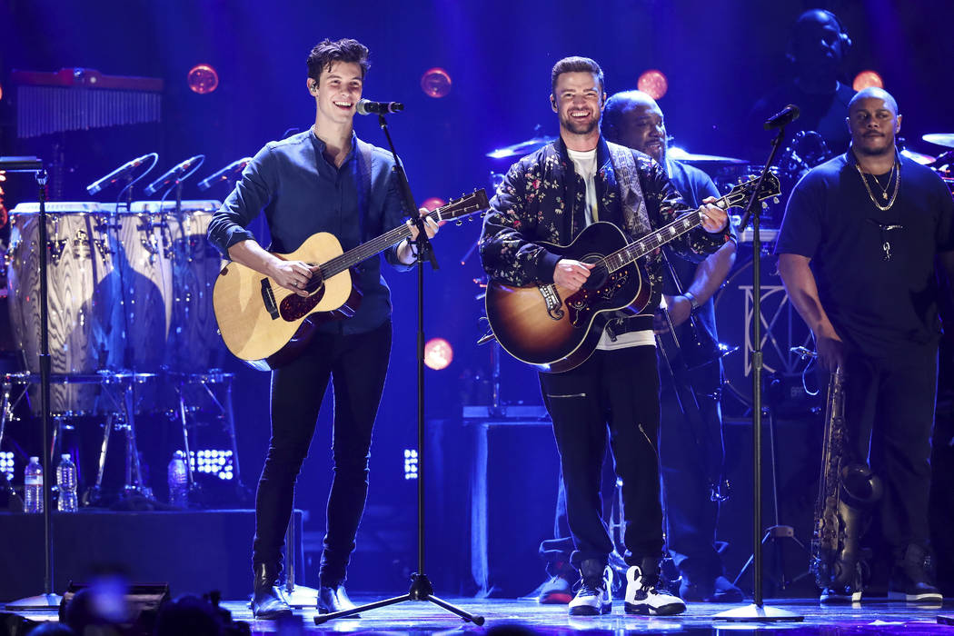 Shawn Mendes, left, and Justin Timberlake perform at the 2018 iHeartRadio Music Festival Day 2 held at T-Mobile Arena on Saturday, Sept. 22, 2018, in Las Vegas. (Photo by John Salangsang/Invision/AP)