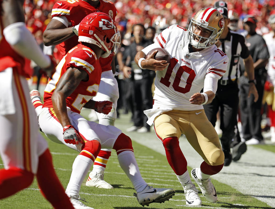 Kansas City Chiefs defensive back Steven Nelson (20) closes in to tackle San Francisco 49ers quarterback Jimmy Garoppolo (10), right, during the second half of an NFL football game in Kansas City, ...
