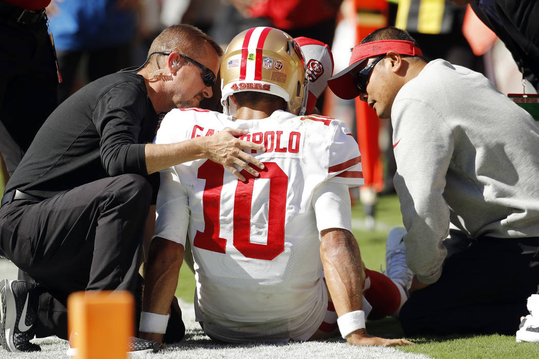 Trainers attend to San Francisco 49ers quarterback Jimmy Garoppolo (10) who was injured after a tackle by Kansas City Chiefs defensive back Steven Nelson during the second half of an NFL football ...