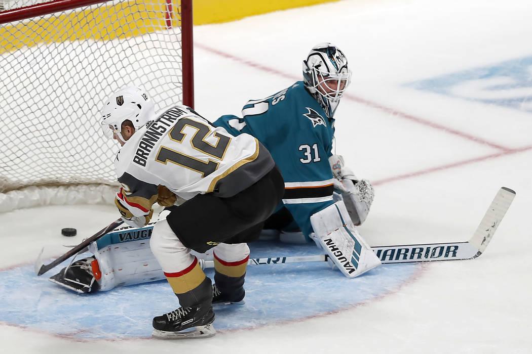 Vegas Golden Knights defenseman Erik Brannstrom (12) scores the winning goal against San Jose Sharks goaltender Martin Jones (31) during the shootout in a preseason NHL hockey game in San Jose, Ca ...