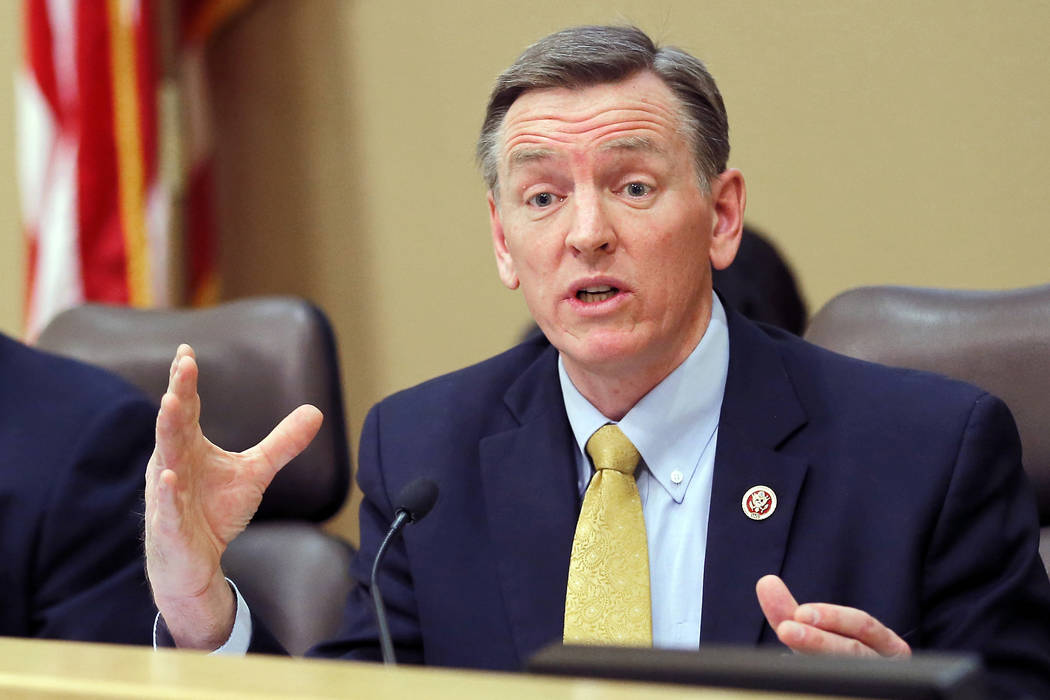In this Dec. 2013, file photo, U.S. Rep. Paul Gosar, R-Ariz., speaks during a Congressional Field Hearing on the Affordable Care Act in Apache Junction, Ariz. Six siblings of Gosar have urged vot ...