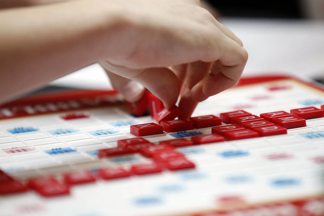 This May 16, 2015 photo released by Hasbro shows a contestant competing in the first round of the 2015 North American School Scrabble Championship at Hasbro headquarters in Pawtucket, R.I. Merriam ...